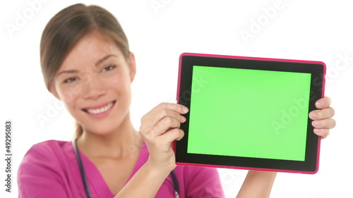 Medical nurse doctor showing tablet pc computer screen