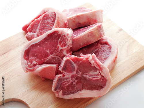 Lamb Loin Chops On Wooden Carving Board