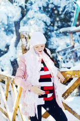 pregnant woman in winter park