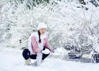 pregnant woman in snow park