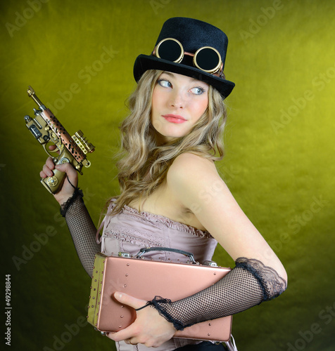 Steampunk woman with gun.
