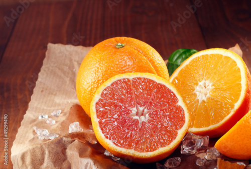 Halved fresh orange varieties