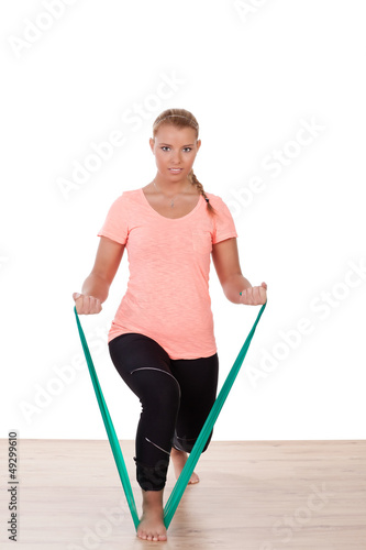 Woman working out with a strap