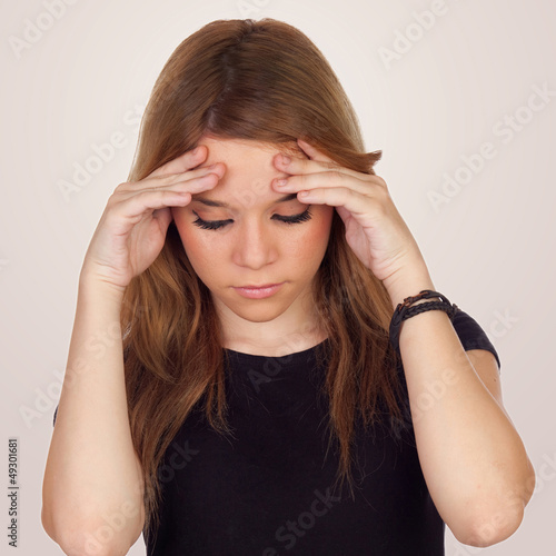Teenager girl with migraine