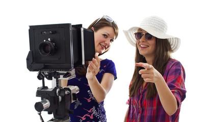 two girls making photos