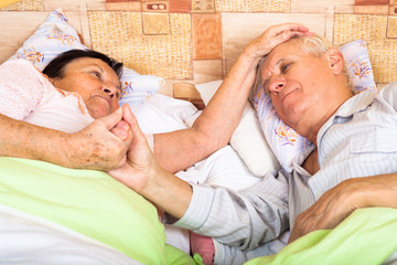 Loving seniors in bed