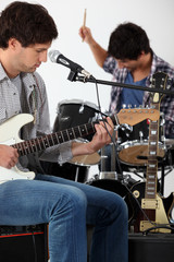 Rock group rehearsing