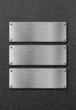three stainless steel metal plates