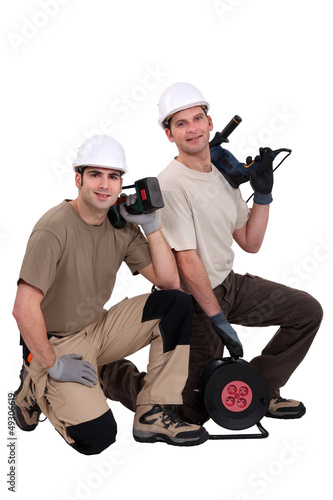 duo of proud electricians