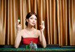 Woman with chips sitting at the casino table