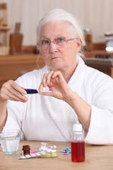 Elderly woman taking her medication