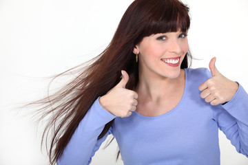 Attractive woman giving two thumbs up