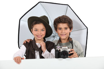 Kids dressed as photographers