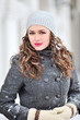 Closeup outdoor portrait of young attractive brunette in winter