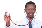 Smiling doctor holding aloft his stethoscope