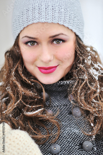 Closeup outdoor portrait of young attractive brunette in winter