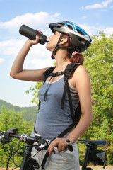 Female biker, drinking water bottle