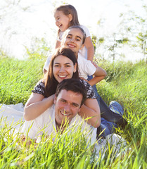 Happy young family with two children