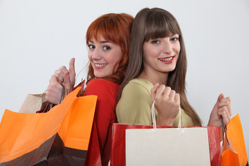 Two friends with shopping bags