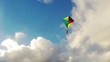 Kite Flying in the blue sky with clouds.