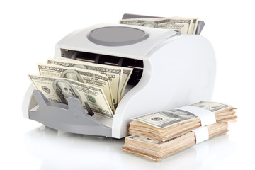 Machine for counting money and 100 dollar bills isolated