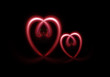 Two light heart sign on  black background