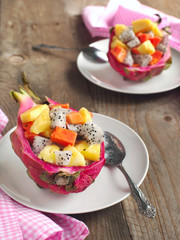 Fresh fruit salad in dragon fruit skin