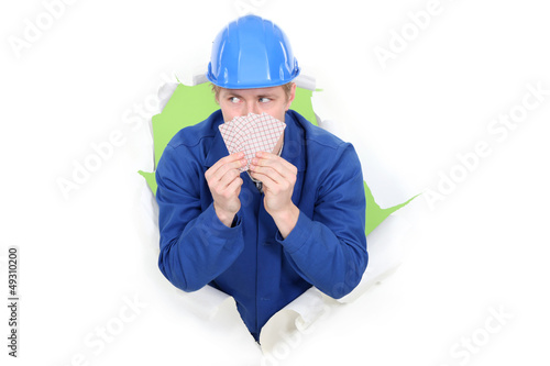 Construction worker with playing cards