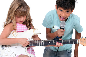children singing and playing music