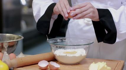 Cook preparing dough in a kitchen