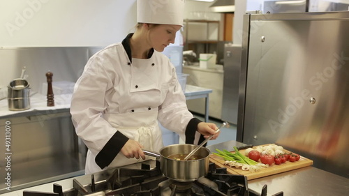 Chef preparing a soup and smelling it