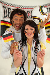 Overjoyed man and woman supporting Germany