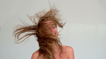 Woman shaking her hair after a shower