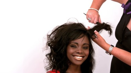 Hairdresser backcombing womans hair