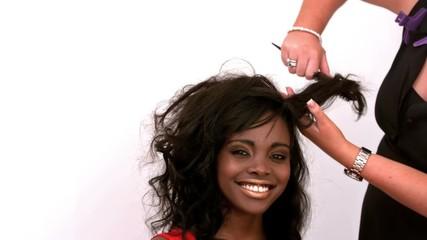 Hairdresser backcombing womans hair
