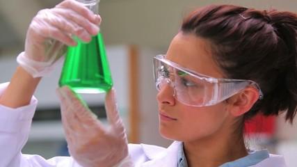 Woman studying the liquid
