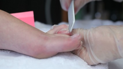 Video of cosmetician polishing toenails