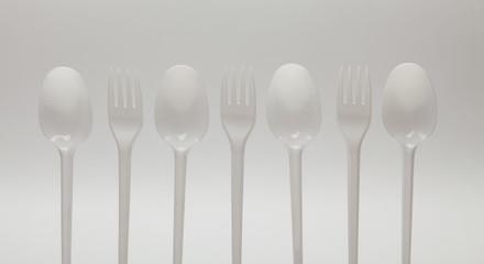 Forks and spoons isolated on white background