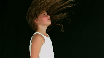Little girl tossing her hair