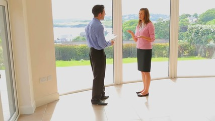 Woman and estate agent shaking hands