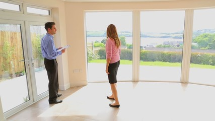 Woman talking with the man about new house