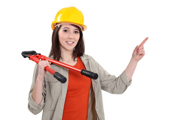Woman with bolt-cutters pointing