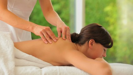 Woman being massaged in a spa center