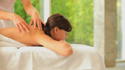 Zen woman having a back massage