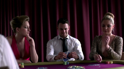 Man sitting winning at poker