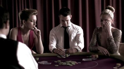 Man sitting winning at poker