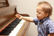 Down Syndrome child playing at piano
