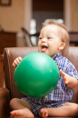 Down Syndrome child playing with ball