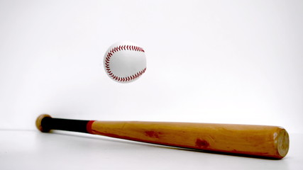 Baseball bouncing near a baseball bat