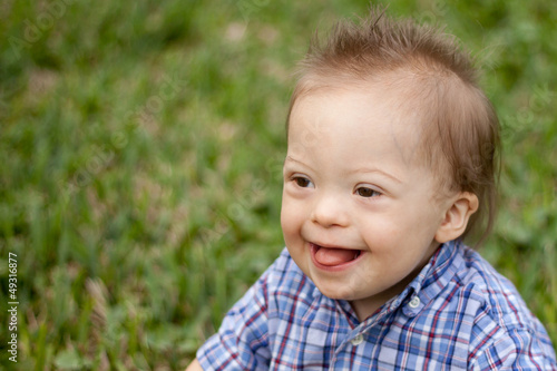 Down Syndrome child laughing and smiling
